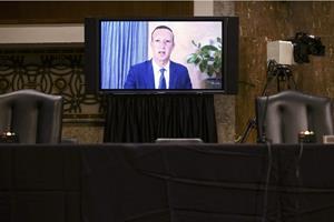 Mark Zuckerberg testifies. (Photo credit: Getty Images).