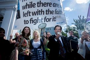 Protest over GP funding threat attracts hundreds of marchers
