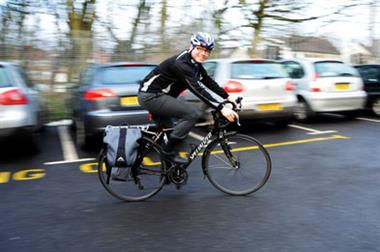 Cycling doctor defies hazardous conditions to see patients