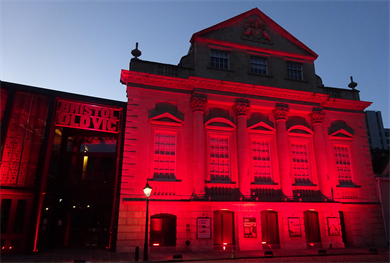 Bristol's Old Vic Theatre lit in red