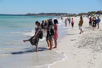 Dreamtime delegates tip their toes at the pristine beaches in Perth