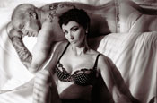 Beckhams' Armani underwear ads spoofed by Paul Daniels