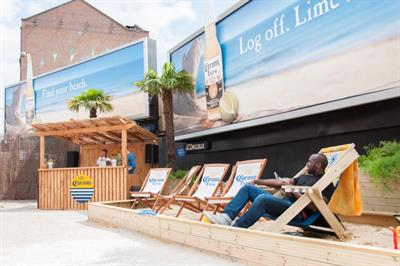 Corona unveils 'beach' at London's Old Street Roundabout