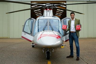 Behind the scenes: Budweiser stages helicopter 'beer drop' for football fans