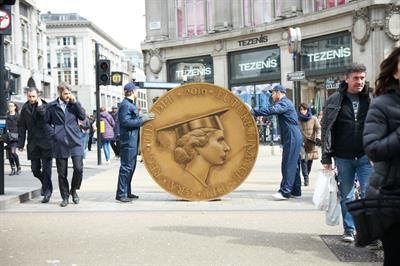 In pictures: Future Finance blocks path of students in coin stunt