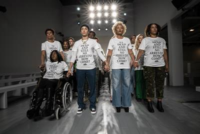 Grenfell campaigners call for justice at LFW
