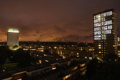 Grenfell United projects messages on to tower blocks to highlight lack of action