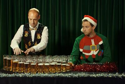 Carling performs Silent Night on beer glasses to 'capture British Christmas spirit'