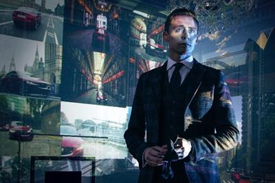 Jaguar mastermind Tom Hiddleston unleashes XE, while feeding Ben Kingsley to big cat