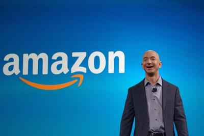 Frenzied pandemic buying pushes Amazon's quarterly revenue past $100bn