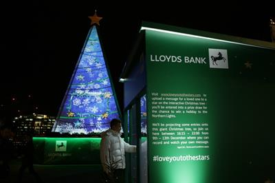 In pictures: Lloyds broadcasts festive videos on luminescent Christmas tree