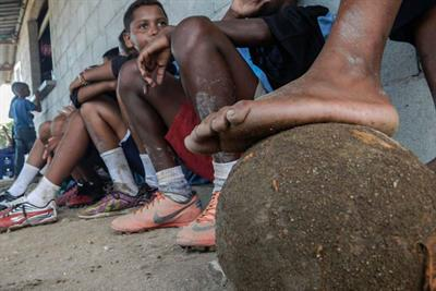 Children of Rio favela given cameras to capture daily lives and love of football