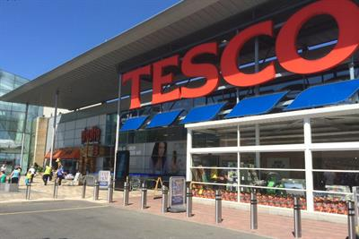 Tesco sees hope after halving sales decline