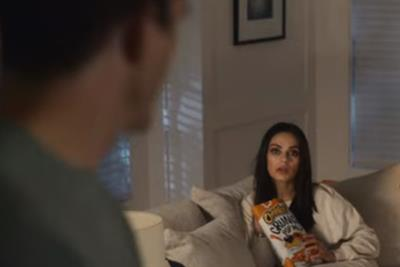 Ashton Kutcher catches Mila Kunis orange-handed in Cheetos Super Bowl spot