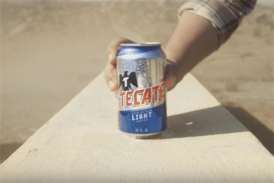 Tecate builds a border wall in new presidential debate spot