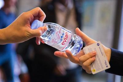 Danone gives away free water to overheated commuters