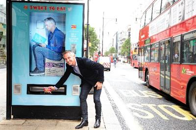 Walkers transforms London bus stops into Twitter-activated vending machines