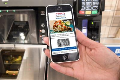 Tesco trials mobile coupons to passing shoppers