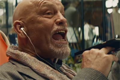 John Malkovich plays hardball with himself in Squarespace Super Bowl spot
