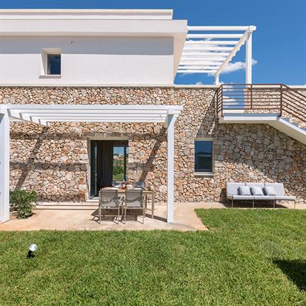 Local stone huts inspire Effkey's design on Italian landscape