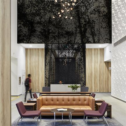 Crown Lobby's interior 30ft metal screen creating abstract forest images
