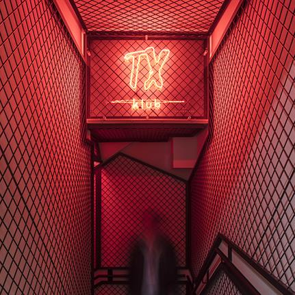 A bar, a club and a suggestive red staircase
