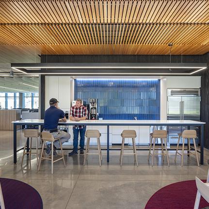 WRNS Studio renovation doubles century-old Okland Construction HQ