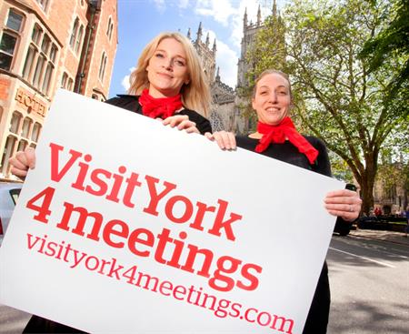 Laura Freer, Business Tourism Manager and Aimee Richardson, Business Tourism Sales & Marketing Executive from Visit York 4 Meetings launching the new brand outside the iconic York Minster