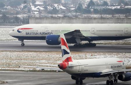 Snowy conditions have caused Heathrow airport to cut flights by 10% today