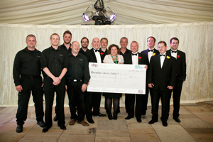 DRP presents £4,000 to Macmillan Cancer Support