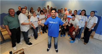 Staff from ACC Liverpool paint Alder Hay Children's hospital