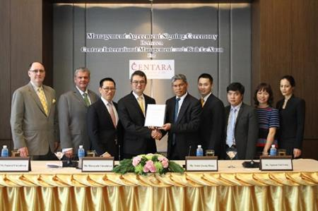 Hotel officials signing the agreement
