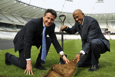 Seb Coe, chair of the London Organising Committee, and Olympian Frank Fredericks lay the final piece of turf at the Olympic stadium earlier this week.