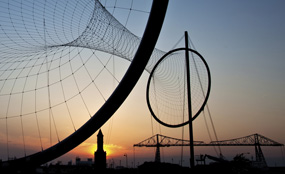 The new Temenos sculpture stands in Middlehaven Dock, Middlesbrough; in the background is the Tees Transporter Bridge