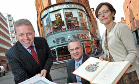 From left: Andrew Irvine, Belfast City Centre Management; social development minister Alex Attwood; and Aoife Ni Riain, librarian, Belfast Central Library