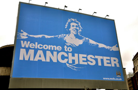 Capacity building: Manchester City's Carlos Tevez could soon be playing at a larger stadium. Johnny Vulkan photo