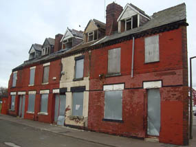 Boarded up homes in the North West of England