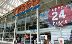 The government's design watchdog says supermarkets in town centres often use the same format as out-of-town proposals.
