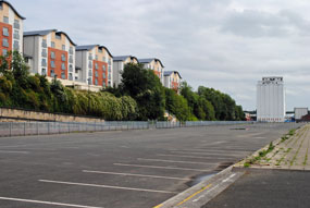 Flats behind an empty car park in Newcastle