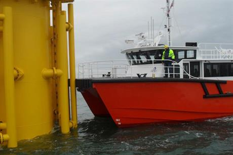 The last leg: Work boats transfer personnel to the wind turbines