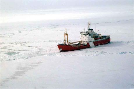 A coastguard vessel breaks ice on frozen Lake Erie in winter