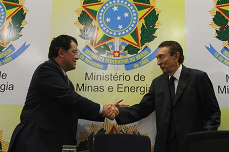 Brazil's new energy minister Eduardo Braga, left, takes over from Edison Lobao, right