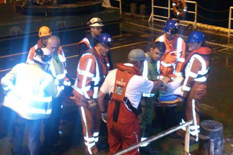 Rescue workers aid the injured man