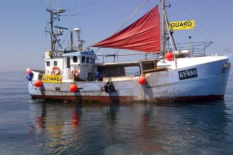 A fishing boat being used as a guard vessel during the construction of an offshore project