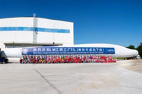 Workers celebrate the production of China's longest wind turbine blade