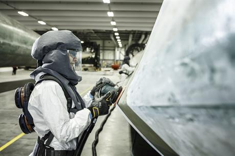 Finishing operative Monika Jedryczka smooths out the surface of a fully-cast blade in the Hull blade factory (pic credit: Siemens Gamesa)