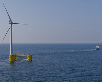 WindFloat platform carrying Vestas v80 2MW turbine being towed into position