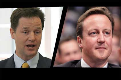 Awkward fit: Clegg (left) and Cameron set for coalition talks
