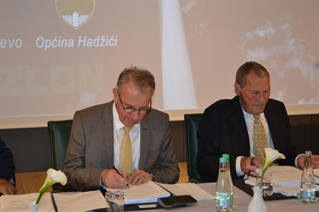 Sarajevo canton economy minister Muharem Sabic, left, and Suzlon's European business development director Erik Winther Pedersen sign the concession