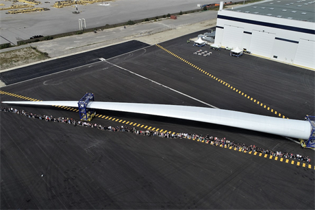 LM Wind Power employees with a 107-metre blade at the manufacturer's facility in Cherbourg, France